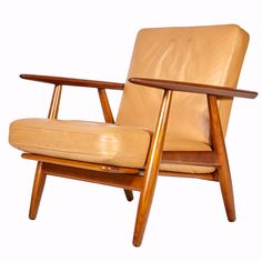 1955 Danish teak GE-240 lounge chair designed by Hans J. Wegner and manufactured by Getama of Denmark. Comes with the original butterscotch leather upholstery. Marked on the underside. Minor wear to t
