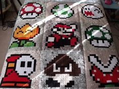 8-BIT MARIO QUILT _name_taken_ made this awesome 8-bit video game quilt featuring characters and items from the Mushroom Kingdom. (via _nam...