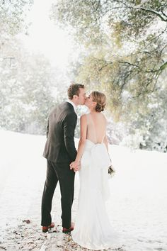 Stunning Backless Wedding Dress in the Snow   onelove photography   Classic Winter Elegance for a Rustic Vintage Barn Wedding