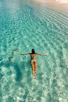 Woman swimming in turquoise clear waters at tropical beach by *michael sweet*