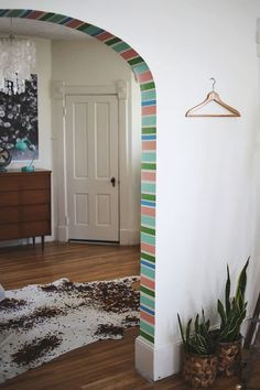 Another new washi tape idea! The arch and doorways between rooms can be a challenge - which room color do you paint it? Try some simple washi tape stripes to make that little space bright and cheery without committing to a new paint color!