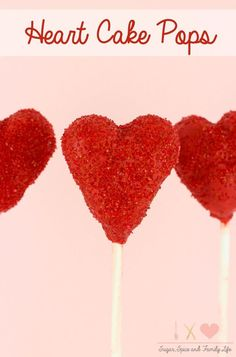 Heart Cake Pops are a cute way to show your love. The heart shaped cake balls are covered in red candy coating and decorated with red sanding sugar. The cake pops are a kid friendly treat that would be great as a Valentine's Day dessert. - Heart Cake Pops Recipe on Sugar, Spice and Family Life