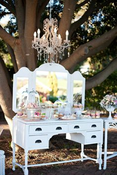 Love some outdoor glam ~ a beautiful wedding dessert buffet displayed on a vintage dresser with twinkling chandelier & pretty sweets! Sweet Table Wedding, Dessert Bar Wedding, Wedding Desserts, Wedding Decorations, Lounges, Vintage Dressing Tables, Vintage Props, Vintage Ideas, Coaster Furniture