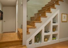 beautiful white wooden staircase with storage space