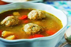 "This recipe for vegetable soup with vegan matzo balls is from Nava Atlas' ""Vegan Holiday Kitchen"" can be made completely gluten-free with quinoa."