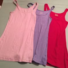 Bundle of 3 tank tops Light pink, purple and red tank top. Very stretchy and in excellent condition. Mossimo Supply Co. Tops Tank Tops
