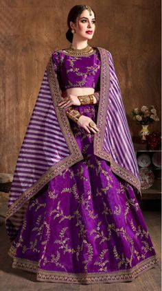 purple colored mulberry silk bridal wedding lehenga with heavily embroidered matching color choli and yellow white stripes printed organza silk dupatta. Lehenga Choli Designs, Lehenga Choli Online, Lehenga Blouse, Bridal Lehenga Choli, Silk Lehenga, Silk Dupatta, Ghagra Choli, Anarkali, Indian Lehenga