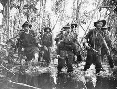 Australian troops slosh through knee-deep water in the jungles of Buna. The stifling heat and swampy, insect-infested terrain took a harsh toll on the morale of many. Ww2 Pictures, Life Pictures, Anzac Soldiers, Australian Defence Force, Anzac Day, Army & Navy, World War Two, Wwii, Battle