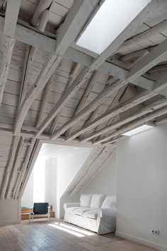 shades of white | love the ceiling | vaulted ceiling, white washed rafters and wood beams.