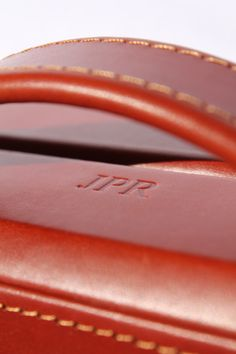 """Embossed by hand onto a leather case...all colours of foil can be used - as well as """"blind"""" (clear foil). #Leather #initials"""
