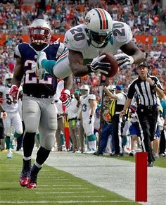 db93d295be0 Miami Dolphins, great action shot! #greatsportsmemes Denver Broncos  Football, Football Baby,
