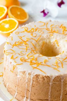 Orange blossom angel food cake from scratch! It's so unbelievable delicious and fairly simple to make! The BEST make ahead cake!