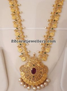 This 22 karat gold Lakshmi coin design is attached to a very light weighted Mala which has the peacocks design attached. Jewelry Design Earrings, Necklace Designs, Gold Jewelry, Gold Necklace, Diamond Necklaces, Diamond Pendant, Diamond Rings, Stud Earrings, Light Weight Gold Jewellery