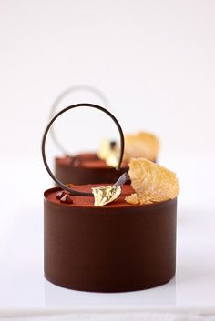 Magnificently chic Cardamom, Chocolate and Almond Nougatine Petit Gateaus.   OMG! to die for!