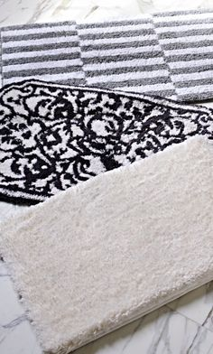 Sooth your soles with superbly soft cotton yarns, woven into gorgeous bath rugs.