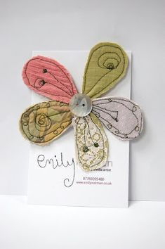 Emily Notman's springtime brooch, so pretty - Would be pretty as a bow.  Cut up practice quilting pieces.
