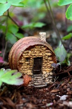 This fairy house was fashioned from an old wine barrel. Note: This is a mini mini house suitable for a terrarium sized garden.