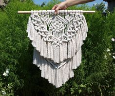 Macrame wall hanging  Color: off-white. Material: unbleached cotton rope, wood. Length of the wood is approx 58 cm (22.5 inches); macrame canvas is approx max 39 x 60 cm (15 x 23.5 inches)   More macrame wall hangings https://www.etsy.com/shop/PapuShoi?section_id=19482238  If you have any question, feel free to contact me.