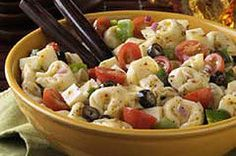 Refrigerated cheese tortellini gives you a jump start on serving this easy antipasto pasta salad to a soon-to-be adoring crowd.