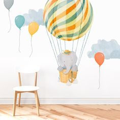 Elephant In Basket is a Mej Mej fabric wall decal from the Nursery Daydreams nursery art collection.