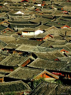 Roofs at Lijiang, China...This is CRAZY, how would you ever find your way out!