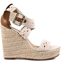 You'll be referred to as royalty when the Magestee is added to your favorite outfit.  Steve Madden features crocheted straps in a sweet summery beige color and adjustable closure.  A raffia wrapped 4 1/2 inch wedge and 1 1/4 inch platform will keep you the fashion ruler in your circle.