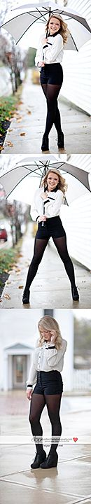 Rainy day shoot with Model Brooke wearing high waisted shorts and an umbrella