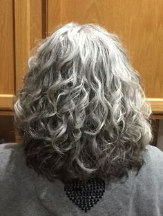 Joli's Silver Hair Journey – Joli started growing out a silver streak at age and later transitioned into a lovely full head of silver curls. She is the founder of QuickSilverHair, an all-natural hair product line for women with gray hair. Grey Curly Hair, Long Gray Hair, Curly Hair Styles, Natural Hair Styles, Grey Hair Over 50, Black Hair, Long Curly, Green Hair, Purple Hair