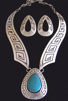 Native American Jewelry - Hopi style overlay design with a turquoise stone in the center pendant. Mary and Everett Teller are a designer team currently living on the Navajo Indian reservation near the Four Corners.
