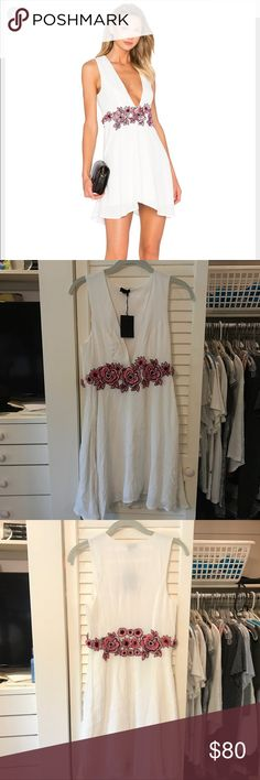 NBD white floral dress Sooo cute NWT. Bought for a graduation party and never ended up wearing it - It is a bit wrinkly from sitting in my closet for awhile but would look perfect after ironed or steamed NBD Dresses Mini
