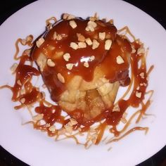 Sweet Apple Dumpling w/ Peanut Butter Caramel sauce topped w/ Nuts.
