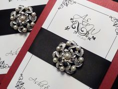 Affordable Custom Pocketfold Wedding Invitations with Rhinestone Buckles and Pearl Brooches.