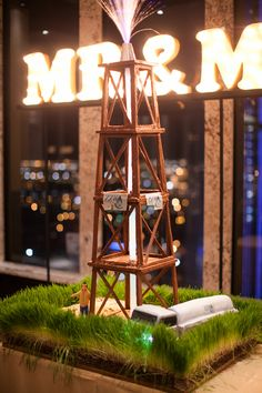 The groom's oil rig cake by Rosebeary's Designs in Baking. Wedding by Planned 2 Perfection. Photo by Josh McCullock Photography. #wedding #cake #groomscake