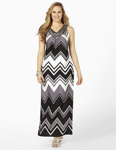 Embellished maxi dress is on-trend and effortlessly flattering with its modern chevron pattern. Sequins, studs, rhinestones and tiny beads shine along the mesh neckline. V-neck leads into cascading gathers below. Silky, sleeveless style is complete with an elastic back waistband for added fit. Catherines dresses are expertly designed for the plus size woman. catherines.com