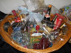 BASKET #10  Date Night Wine Basket: 4-Wine Glasses, 8-Bottles of Wine (Chardonnay, White Zinfandel, Moscato and Sangria to name a few), Houdini Wine Tool Kit, Monkey Wine Sock, Wine Gem Charms, Wine Discs (For Men), Candle (Peaceful Waters), $25.00 Olive Garden Gift Card. Olive Garden Gift Card, White Zinfandel, Wine Baskets, Sangria, Tool Kit, Fundraising, Diy Gifts, Sock, Monkey