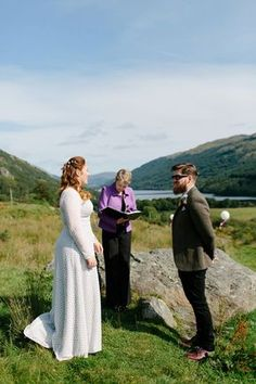 Bride India wears a 1970's inspired gown by Rowanjoy for her Icelandic inspired bohemian and free spirited wedding at Monachyle Mhor in Scotland. Photography by Caro Weiss.