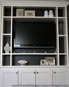 paint back of book cases darker (if white or grey cabinets)