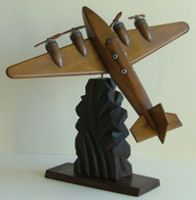 Art deco airplane statue. I tend to prefer the silvery ones, but this wooden one is pretty amazing.