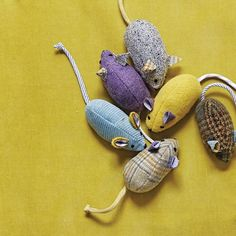 Treat a kitty to a game of cat and mouse with a few dapper toys. There's no mistaking these critters for the real thing -- they're constructed from brightly colored suiting and shirting fabric.