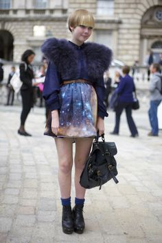 I don't even know where to start with this look...eggplant faux fur collared top, cosmic print skirt, blonde pixie! I love it all!