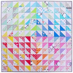 A Rainbow Half Square Triangle Quilt - Red Pepper Quilts. Like the rainbow quadrant effect