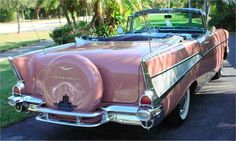 OOOOOOOOH - Pink!  1957 Chevy Bel Air Convertible, with Continental Kit.  My first boyfriend had a red one with a stick shift.