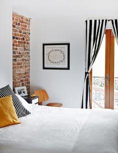exposed bricks, chair + stripes | via the design files