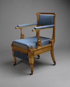 c. 1828 German armchair. Gilded mountain ash; brass mounts and casters; modern upholstery