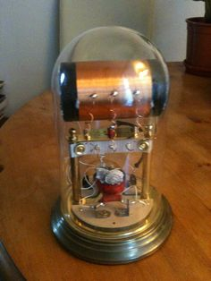 Astonishing crystal radio built inside a bell jar with galena rock set into a seashell. Beautiful, functional and very valvepunk.