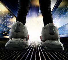 2394860cc651 ThinkGeek has released a futuristic pair of Giant Robot Slippers with Sound  Effects that will make your feet look and sound as if you received awesome