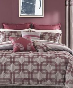 "Bryan Keith Modern Classics  ""Burgundy Verick"" Collection  9 Piece Reversible King Comforter Set    Undeniably modern, the Bryan Keith Portland reversible comforter set offers two sophisticated patterns for a multitude of mix and match possibilities. One side of the comforter and shams feature bold stripes while the other boasts interlocking rings. Ribbed European shams and striking decorative pillows finish the look in style."
