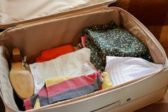 Living out of a suitcase for three months has taught me just how few possessions I need to enjoy life. Travel Necessities, Save Your Money, Organization Hacks, Organizing, Travel Light, Bassinet, Diaper Bag, Toddler Bed, Investing