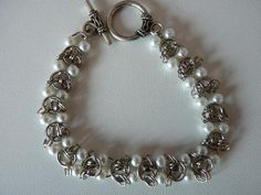 Chainmaille and pearl bracelet  http://www.cutoutandkeep.net/projects/chainmaille-pearl-bracelet