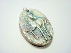 Pale Blue Silver Handmade Polymer Clay Unicorn Pendant by PennysLane, $6.00